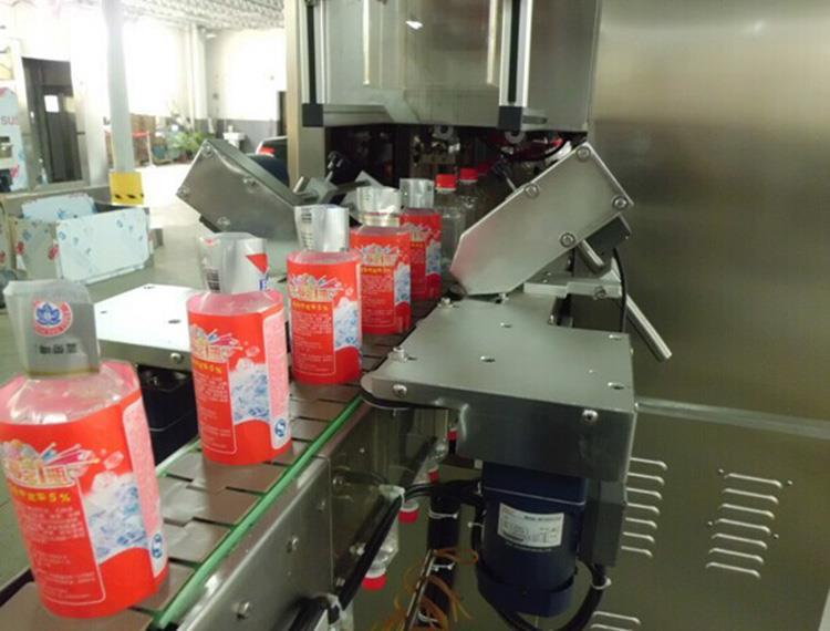 Het automatische Dubbele Hoofdetiket van Hittepvc krimpt Koker Etiketteringsmachine